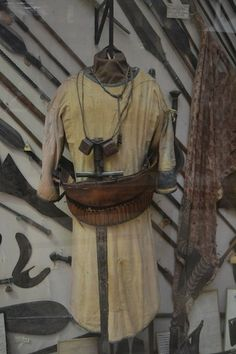 A Mahdist robe,  Note the homemade ammunition belt and amulets worn around the neck.