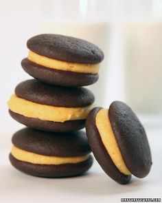 MIni Pumpkin Whoopie Pies. I bet they're delicious. How to: http://www.marthastewart.com/354430/mini-pumpkin-whoopie-pies?czone=holiday/halloween-center/halloween-center-desserts=true=/photogallery/halloween-cookies-recipes