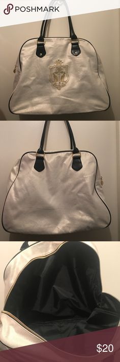 Katy perry bowling bag/overnight purse Super cute never used, just wrinkly from sitting in my closet. This bag is big enough to use as an overnight bag! it reminds me of juicy couture and is a pretty gold that has a shimmer to it katy perry Bags Totes