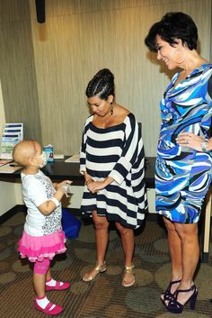 Kourtney in a Cameo dress, Pucci sandals, Nissa earrings and Chanel clutch.