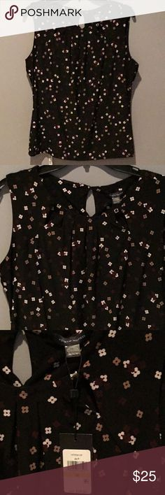 Tommy Hilfiger blouse  Super cute floral patterned sleeveless shirt with adorable silver need accents and key holes on each arm and back of neck. Shirt is black with white, tan and maroon flowers  Tommy Hilfiger Tops Blouses
