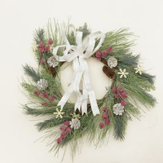 WREATH -  BOW WITH BERRIES  PINECONES & SNOWFLAKES