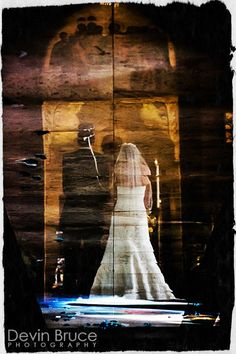 A reflection of the bride and groom on the polished floor during an Orthodox Greek wedding.