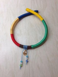 Multi-coloured string necklace