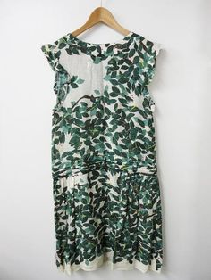 Leaves dress. I can see this dress blowing  beautifully on a lean frame, with some colorful shoes and a pendant. A fun summery dress.