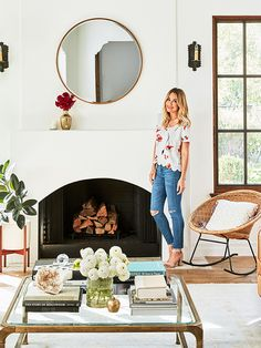 Circular mirror over fireplace - Home Tour: Inside Lauren Conrad's Cali-Cool Pacific Palisades Abode via @MyDomaine