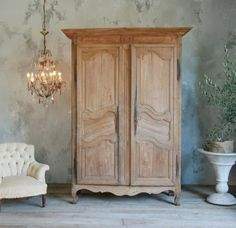 Gorgeous antique armoire from Provence in pale sun bleached oak. Classic old serpentine panel doors - a stunning old piece. Circa 1780.