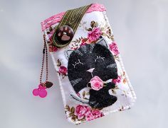 Show your style and have some fun with this beautifully 90% hand-stitched and 10% machine embroidery pouch to protect your cell phone or favorite