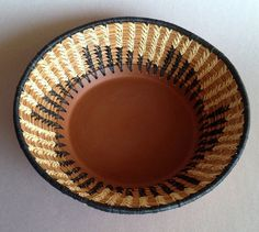 pine needle basket with red clay base by NeedlesandClay on Etsy, $120.00