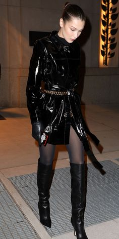 Look of the Day - Leather Boots - Ideas of Leather Boots - Bella Hadid kept the patent leather trend going with a shiny black jacket cinched with a gold belt. All she needed to complete her look were sheer tights over-the-knee boots and leather gloves. Patent Leather Boots, Black Leather Gloves, Leather Over The Knee Boots, Trent Coat, Girls Casual Dresses, Sheer Tights, Hot High Heels, Bella Hadid, Leather Fashion