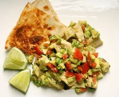 Guacamole Chicken Salad    * 1 cup cooked, diced chicken breast  * 2 tablespoons minced chives  * 1 small avocado, peeled, pitted and finely chopped  * 1 medium tomato, cored and diced  * 1 to 2 teaspoons minced jalapenos  * 2 teaspoons fresh lime juice  * 2 tablespoons olive oil  * 1/4 teaspoon salt or to taste  * 1/4 teaspoon fresh-ground black pepper or to taste    Combine chicken, chives, avocados, tomatoes and chiles in a salad bowl. Stir together remaining ingredients; pour over salad.