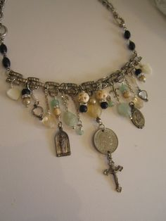 vintage repurposed jewelry assemblage necklace religious charm crucifix rhinestone bracelet rosary beads by atelier paris.  via Etsy.