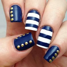 Blue and white with gold studs nail art