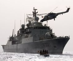 Portuguese Navy's NRP Álvares Cabral frigate and Lynx helicopter.