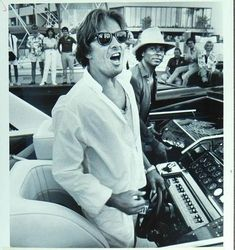 Cruising: Don Johnson and Philip Michael Thomas pull up to the Miami Marina in July 1985 to publicize the Miami-New York Offshore Challenge race.