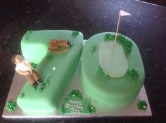 Golf theme birthday cake for a 70th birthday by www.cupboardlovecakes.com