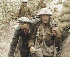 British soldier escorting wounded German prisoner