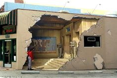 This is a mural. Even the woman standing there is part of the mural. Can you say amazing?