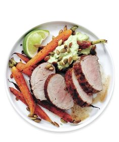 Creamy avocado sauce and crunchy pepitas punch up cumin-spiced pork. Get the recipe for Mexican Pork Loin and Carrots.