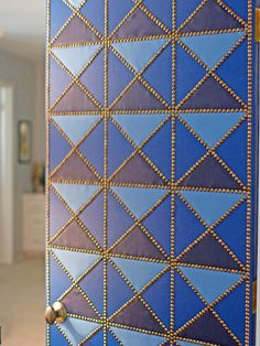 DIY: geometric upholstered door  I would love to have my studio door look like this!