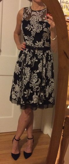 A knee length summer dress with embroidered flowers