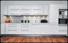 Love the modern white cabinets!