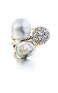 Two keshi pearl rings and a pavé set sphere ring with diamonds.