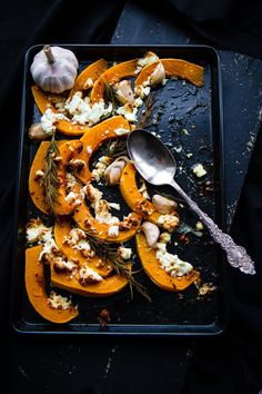 Roast butternut squash with feta and harissa creme fraîche.