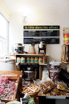 This is my idea of France and Frenchmen!!! How adorable!!! I want to stop by.....Olives and only olives, I love it! La Tête Dans Les Olives, Paris