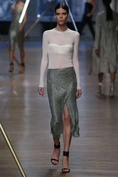 Jason Wu RTW Spring 2014 - tone-on-tone bustier under a sheer long-sleeved blouse and sparkly slitted midi skirt