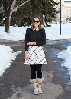 Just fab winter outfit. Really love the sweater-skirt combo with the collar popping out. Paired with the black tights and winter boots and voilà, super chic outfit.