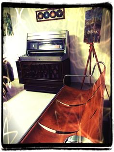 A sofa and a jukebox of the sixties