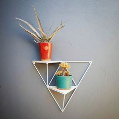 These cool and modern geometric shelves are perfect for displaying your plants and succulents. The shelves are entirely handmade. They are made of metal, and painted with white enamel paint. The shelving boards are made from recycled fibre cement boards. If you would like any variations in colour or size give us a shout and we can give you a quote. Sizing: 46cm height, 50cm width, 22cm depth * Plants not included Fiber Cement Board, Geometric Shelves, Plant Shelves, Enamel Paint, Plant Design, White Enamel, Store Design, Shelving, The Balm
