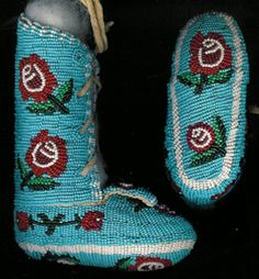 "Native American Indian Style,fully beaded baby burial moccasins,Northern Cheyenne Style with floral pattern.  This is a contemporary expression of traditional beadwork.  Museum quality.  Provenance & artist unknown. These measure 5 1/4""H x 4 3/4""L x 2 ""W."
