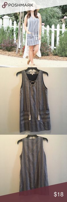 Summer Shift Dress Cute little dress for summer, or the beach! It's an embroidered material and great quality. Fully lined with a tie up front. Size Small. Would fit a medium too. Worn once for a photoshoot. Dresses Mini