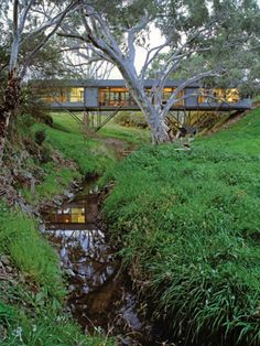Green Bridge House  1,184 square feet   Max Pritchard Architect   Ashbourne, Australia    According to Small Eco Houses, the Bridge House was built for a client who didn't want to spoil the natural beauty of their property. So the architects came up with a rectangular design that bridged over a small stream.