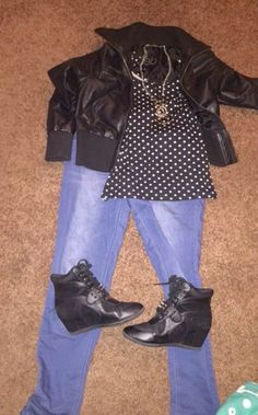 Today's outfit. Blue jeans and a black tank top with white polka dots. A black leather jacket and black sneaker wedges with a gold necklace,