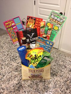 "Ummm can we say best wife ever? A DIY easter basket for your husband! I'm surprising Scott with this ""adult"" easter basket on sunday! Cant wait to give it to him, hope he likes it!! :D"