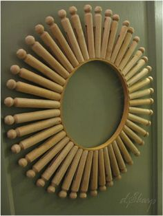 Wooden clothespin wreath- would look cool with a round mirror glued on top.  DIY