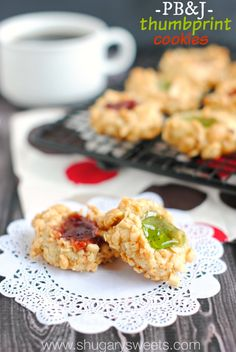 Thumbprint Cookies: delicious cookies wrapped in chopped peanuts and a dollop of jelly! Festive for Christmas!
