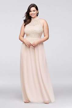25df5ac8174 The high-neck illusion bodice of this lace and chiffon plus-size gown has