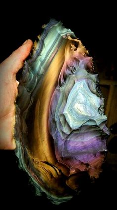Spectacular rainbow obsidian blade (from Davis Creek, California material). credit:.Woody Blackwell.  Rainbow Obsidian is black obsidian that, when polished and exposed to a strong light, shows bands of rainbow colours. Rainbow obsidian is said to be the stone used by Nostradamus to foresee future events.