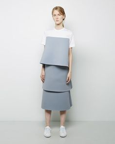 Jacquemus via largarconne.com the use of structural layering with the bonded blue fabric is really effective.