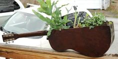 The Upcycled Guitar - planter made from an old guitar