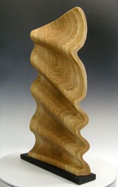 "Abstract wave form that highlights marbled grain figure and medullary rays. 30""H x 17""W x 4""D, Marbled Pin Oak with a carved and sandblasted surface texture, oil finish."