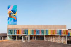 r2k architectes: groupe scolaire pasteur, france. Colourful wooden slatted facade and artwork giving the school a branding identity.