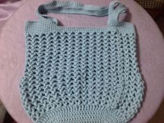 Twisted V stitch bag. Pattern available on Ravelry: http://www.ravelry.com/patterns/library/twisted-v-stitch-bag