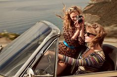 "Shooting Stars The two recently road-tripped through Big Sur. ""Taylor's a really good driver,"" Kloss says. Saint Laurent by Hedi Slimane woven Lurex dress, blue leather belt (on Kloss), sequined V-neck sweater, and studded belt (on Swift). On Kloss: Barton Perreira sunglasses. Cartier ring. On Swift: Ray-Ban sunglasses. Fashion Editor: Tonne Goodman - Photographed by Mikael Jansson, Vogue, March 2015"