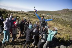 A hero's welcome greets Rozov on landing Kilimanjaro, Base, Hero, Adventure, Landing, How To Make, Sports, Hs Sports, Sport