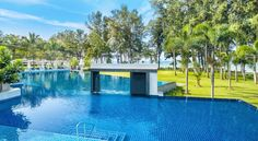 Dusit Thani Krabi Beach Resort This property is a 4-minute walk from the beach. Dusit Thani Krabi Beach Resort is a 5-star property situated on the white sands of peaceful Klong Muang Beach. It features large outdoor pools in tropical gardens, a day spa and 24-hour fitness facilities.